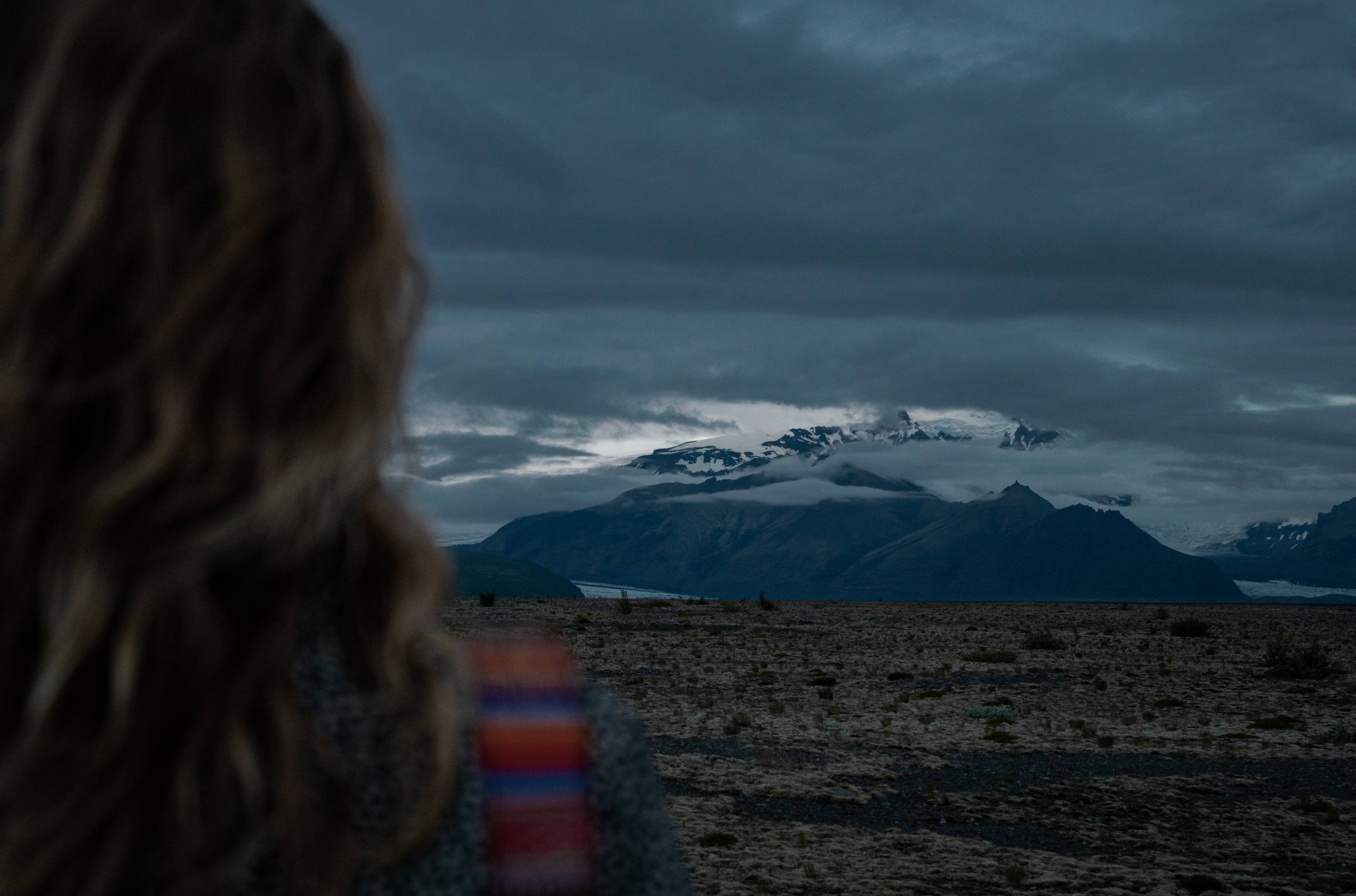 Girl looking at a mountain in Iceland