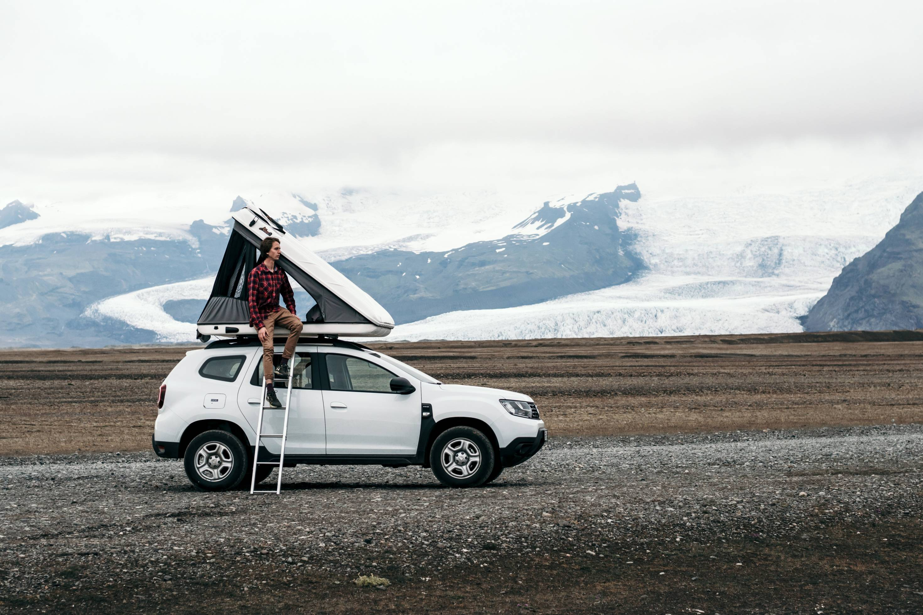 Man by Roof Tent Vehicle