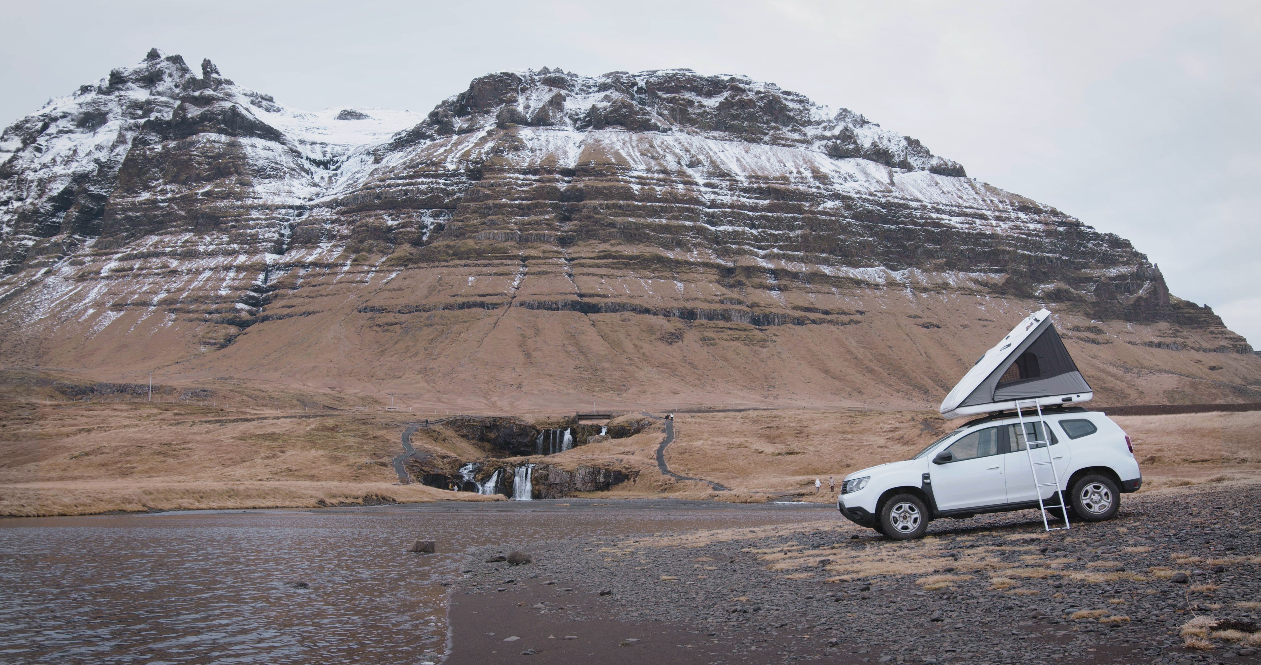 Dacia Duster with roof top tent iceland kirkjufell
